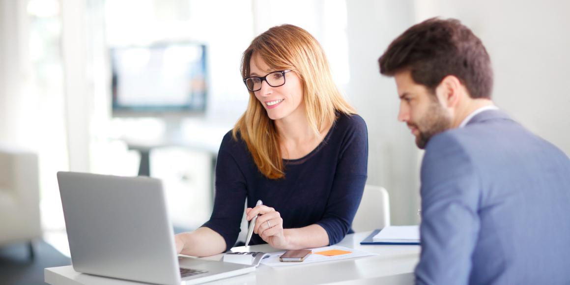 woman on laptop showing credit union digital transformation